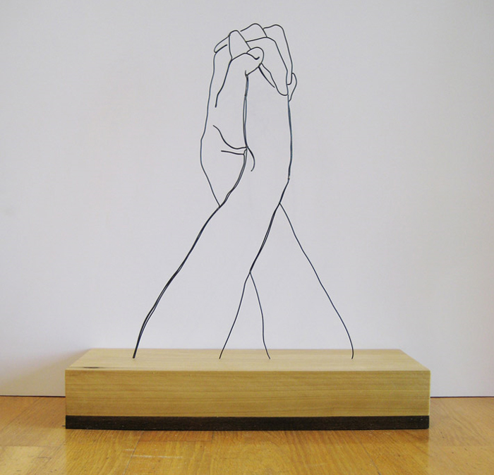 """Hands Clasped"" wire sculpture"